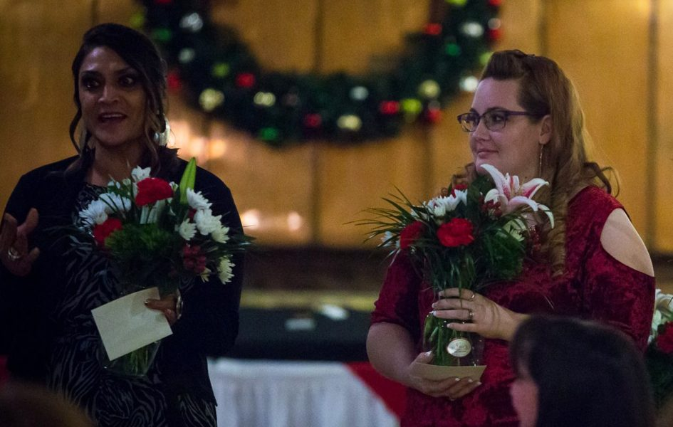 women holding bouquets at coldwell holiday party