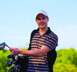 close-up of male golfer smiling for portrait
