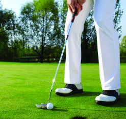 close-up of golfer getting ready to hit the ball