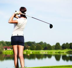 close-up of female golfing