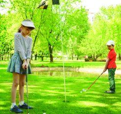 two kids golfing